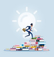 businessman climbing to the top of book piles vector image