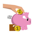 hand inserting coin to piggy vector image vector image