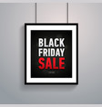 black friday sale poster in frame hanging on ropes vector image vector image