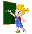 girl writing on blackboard vector image vector image