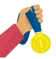 Hand holding golden medal vector image