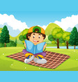 a boy reading book in park vector image