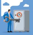 businessman with key near vault room safe door vector image
