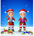 cartoon boy and girl bringing gift box in the wint vector image vector image