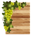 White grapes on a wooden background vector image vector image
