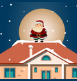santa hold gift on snowy roof vector image vector image