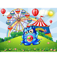 A baby monster at the hilltop with a carnival vector image vector image