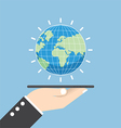 Businessman hand holding tablet with globe vector image