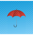 Opened red umbrella protecting from rain vector image