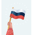 human hands holding russian flag vector image vector image