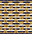 striped pattern with gold glittering lips vector image