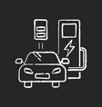 charging station chalk white icon on black vector image vector image