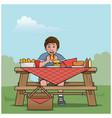 boy at a picnic table vector image