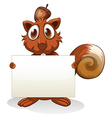 A squirrel holding an empty signboard vector image vector image