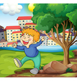 A happy young boy near the tree vector image vector image