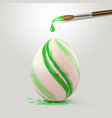 green easter egg and paintbrush vector image vector image