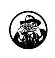 photographer wearing fedora shooting camera retro vector image vector image