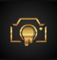 gold camera with a leaky lens on a black vector image vector image