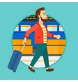 Man walking with suitcase at the airport vector image vector image