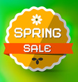 Spring Sale Orange Label on Green Bokeh Background vector image