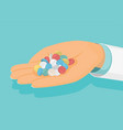 doctor holds a handful of pills in hand medical vector image