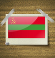 Flags Transnistriaat frame on a brick background vector image
