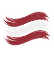 grunge brush stroke with national flag of latvia vector image vector image