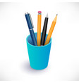 pens and pencils in blue cup vector image vector image