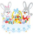 Rabbits with an Easter basket vector image vector image