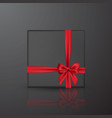 realistic black gift box with red bow and ribbon vector image vector image