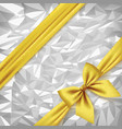 gold ribbon and bow on bright silver foil texture vector image