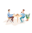 two men are talking at a table in a cafe vector image