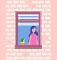 woman standing near open window flower pot vector image vector image
