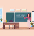woman teacher writing home work at chalk board vector image vector image
