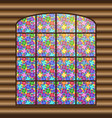 antique large window with a multi-colored