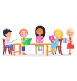schoolchildren sitting at desk and reading books vector image vector image