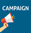hand holding megaphone with campaign announcement vector image