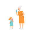 grandmother and her little granddaughter eating vector image vector image