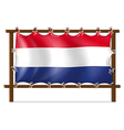 The flag of Netherlands attached to the wooden vector image vector image