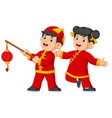 two happy kids holding the chinese paper lantern vector image