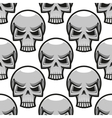 Seamless skulls pattern in cartoon style vector image vector image