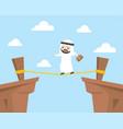 arab businessman walking on rope across cliff vector image vector image