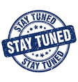 stay tuned blue grunge round vintage rubber stamp vector image vector image
