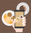 hand holding smart phone take photo of coffee vector image vector image