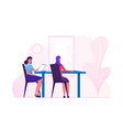 couple female business characters sitting at vector image