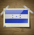 Flags Honduras at frame on wooden texture vector image