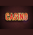 casino neon sign on brick wall vector image vector image