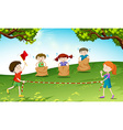 Children play jumping sack in the park vector image vector image