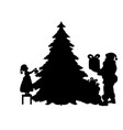 silhouette santa put gifts and girl decorates vector image
