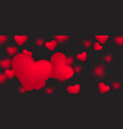 falling small red realistic hearts on black vector image vector image